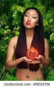 Woman hold garnet fruit