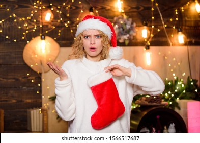 Woman hold red stocking. New year celebration. Buy or knit your Christmas stocking and stuff them with special goodies. Stocking stuffers ideas. Candies gift certificates subscriptions tickets.