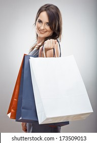 Woman hold shopping bag. Isolated portrait.