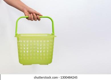 Woman hold shopping basket isolated on white background.