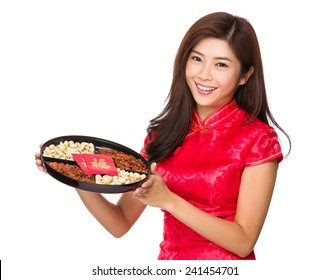 Woman hold with traditional snack tray