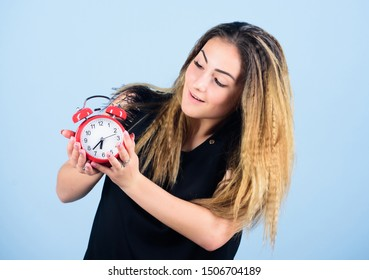 Woman hold vintage alarm clock. Practice of advancing clocks. Daylight saving time. Change time zone. Watch repair. Time management. Punctuality and discipline. Pretty girl managing her time.
