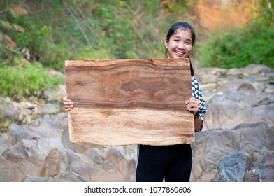 Woman Hold the wood Sign wood rock tree sunlight background