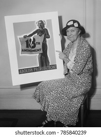 Woman holding a 1931 poster 'Abolish Prohibition!' In 1933 state conventions ratified the Twenty-first Amendment, which repealed Prohibition