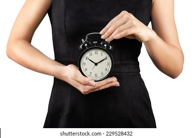 Woman holding alarm clock in hands, isolated on white, time is money