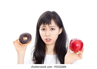 woman holding apple and donut, isolated on white background