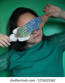 Woman holding arowana fish