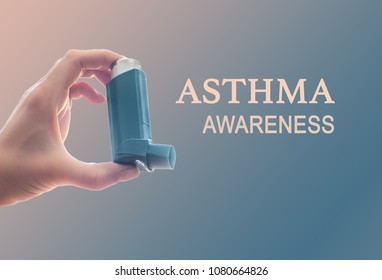 Woman holding asthma inhaler in her hand