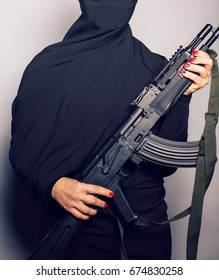 Woman holding an automatic weapon.
