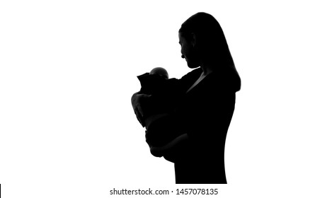 Woman holding baby doll as her own child, sadness for lost new-born, abortion