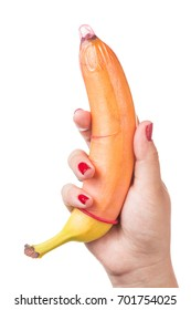 Woman holding banana with condom isolated on white background. Masturbation Man Penis Erection Condom Satisfaction Sex Woman Hand Concept.