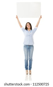 Woman holding up a banner - isolated over white background