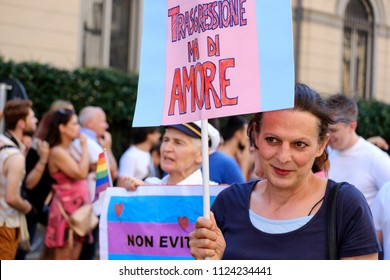 Woman holding a banner with a messagge in favor of love without discriminations. Gay Pride Parade in Milan, Italy. June 30, 2018.
