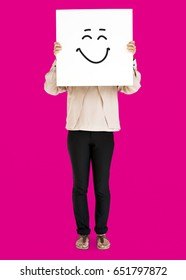 Woman holding banner with smiley face