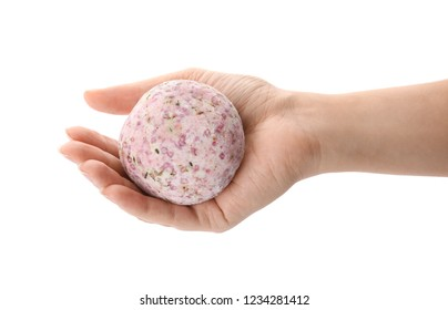 Woman holding bath bomb on white background, closeup
