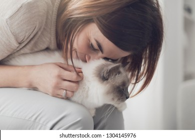 Woman holding a beautiful cat on her lap, pets and lifestyle concept