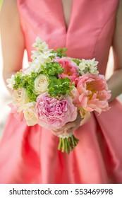 woman holding beautiful flower bouquet