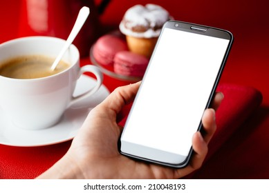 Woman holding big cellphone for reading or sending message on copy space screen at breakfast with coffee in restaurant.