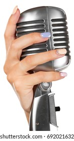 woman holding big retro microphone for singing