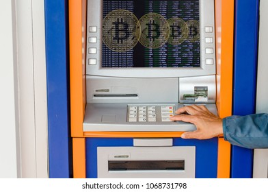 Woman holding a bitcoin on a ATM background.The concept of using digital currency. Concept.