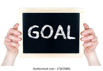 Woman holding blackboard with word Goal