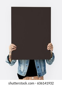 Woman holding blank banner cover face studio portrait
