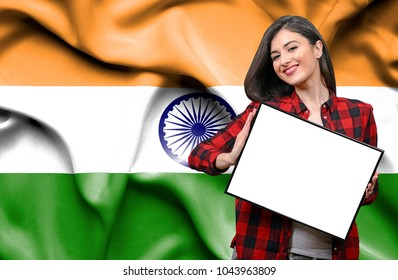 Woman holding blank board against national flag of India