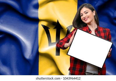 Woman holding blank board against national flag of Barbados