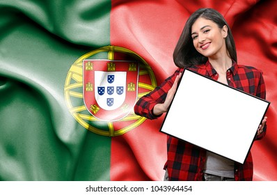 Woman holding blank board against national flag of Portugal