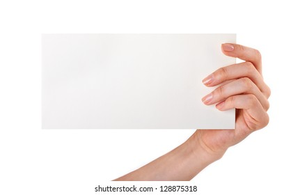 Woman holding blank business card in hand isolated on white