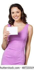 Woman holding blank card.