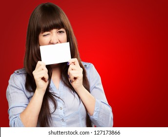 Woman Holding Blank Card Isolated On Red Background