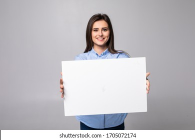Woman holding blank card. Isolated on white background smiling female portrait.