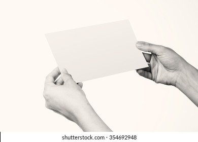 Woman holding blank corporate identity package letter - includes clipping path, ready for your artwork - black and white