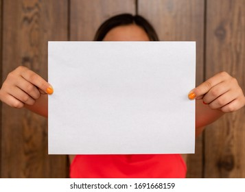 A woman holding blank paper