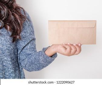 Woman holding blank paper envelope. Mockup for design