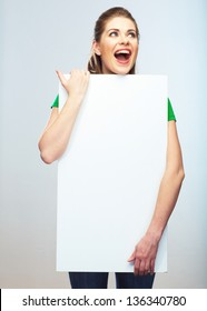 Woman holding blank poster isolated studio portrait.