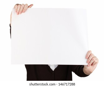 Woman holding blank sign in front her face, isolated on white
