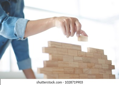 Woman holding blocks wood game - Building and risk concept