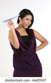 woman holding blue paper plane