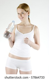 woman holding bottle of water