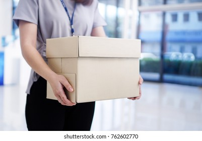 Woman holding the box unemployed
