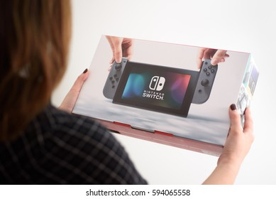 A woman holding a brand new Nintendo Switch console in Yonkers, New York on March 5, 2017.