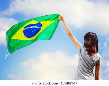 Woman holding a brazil flag