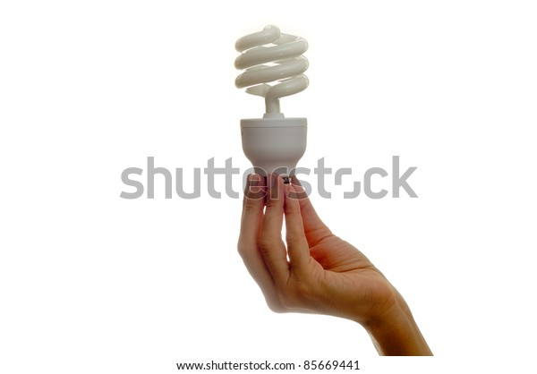 Woman holding bulb over white background