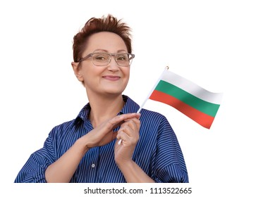 Woman holding Bulgarian flag. Nice portrait of middle aged Bulgarian lady 40 50 years old with a national flag of Bulgaria isolated on white background.Learning Bulgarian. Visit Bulgaria concept.