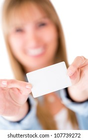 Woman holding a business card - isolated over white background