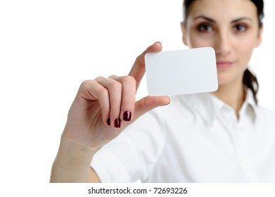 Woman holding businesscard in hand. Focus on card.