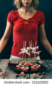 Woman holding cake pops.Selective focus and small depth of field.