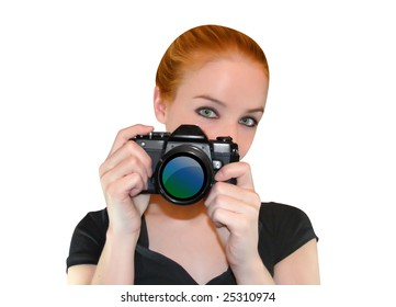 A woman is holding a camera and looking into a camera ready to take a photo.